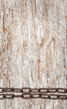 Metal chain on the old wood Royalty Free Stock Photo