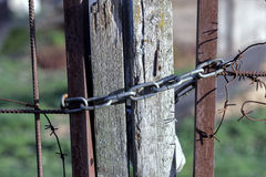 Metal chain on old wooden fence Stock Photos