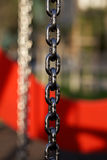 Metal chain with red background Royalty Free Stock Image
