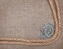 Metal chain, rope on the burlap Stock Images