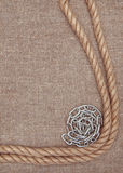 Metal chain and rope on the burlap Royalty Free Stock Image