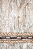 Metal chain and rope on the old wood Royalty Free Stock Photography