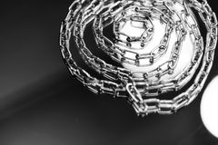 Metal chain in silver color. Photographed in different positions - Folded and the unfolded variant Royalty Free Stock Images