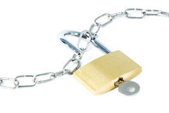 Metal chain and an unlocked padlock with key. In the keyhole, isolated on white background Stock Photo