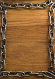 Metal chain on wood Royalty Free Stock Image