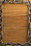 Metal chain on wood Royalty Free Stock Photography