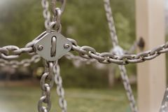 Hanging metal chains royalty free stock photography