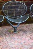 Metal chair. A public metal chair on the promenade  in small city Saarburg, Rheinland-Pfalz, Germany Stock Image