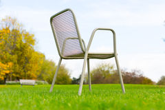 Metal chair on a green lawn Stock Photos
