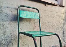 Metal chair outdoors Stock Image