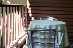 Metal chair on terrace balcony near garden. Park Royalty Free Stock Images