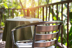Metal chair on terrace balcony near garden. Park Stock Photo
