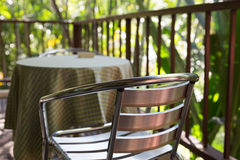 Metal chair on terrace balcony near garden. Park Royalty Free Stock Photography