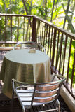 Metal chair on terrace balcony near garden. Park Royalty Free Stock Photos