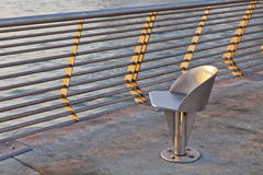 Metal chair at waterfornt Royalty Free Stock Photo