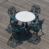 Metal chairs and round table Royalty Free Stock Image