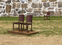 Metal chairs at the walls of the old fortress Royalty Free Stock Image