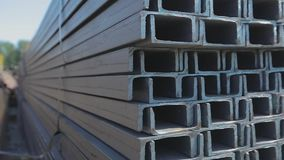 The metal channel laid in rows in the open metal warehouse, the large metal channel in the warehouse.  stock footage