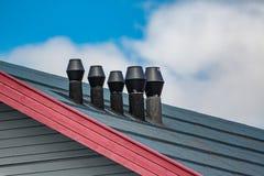 Metal chimneys in Longyearbyen, Svalbard, Spitzbergen, Norway. In spring Stock Photos