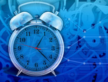 Metal chrome alarm clock  on abstract Royalty Free Stock Photos