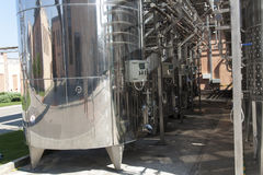 Metal chrome cask for wine photo. Stainless steel pipes and barrels as part of winery equipment.  Stock Image