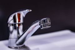 Metal chrome sink mixer tap for bathroom water. close up. Metal chrome sink mixer tap for bathroom water, close up stock photos