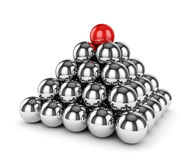 Metal chrome sphere pyramid with one red on top  Royalty Free Stock Photos
