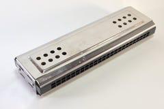 Metal chromed double-tone two keys mouth organ. Closeup. Diatonic tremolo harmonica. Metal, chromed, Close-up Stock Photos