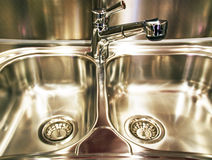 Metal chromeplated kitchen sink. The crane for water and metal chromeplated kitchen sink royalty free stock photos