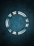 Metal circle on a scratched background Royalty Free Stock Photography