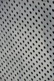 Metal circles. Metal sheet with circles cut into it Stock Images