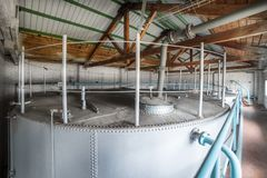 Metal cisterns installed inside the building. Royalty Free Stock Photography