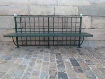 Metal city bench on street Royalty Free Stock Photo