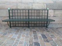 Metal city bench on street Royalty Free Stock Photo