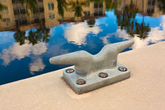 Metal cleat on a concrete dock Royalty Free Stock Photography