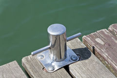 Metal cleat on the lake Royalty Free Stock Photography