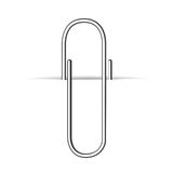 Metal clip, paperclip on white paper Royalty Free Stock Photos