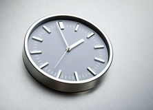 Metal clock on the wall of steel. The concept of time Stock Image