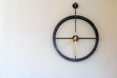 Metal clock watch on the wall. Stock Photo