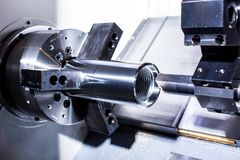 Metal clutch in a lathe. Metalworking. cnc lathe royalty free stock image