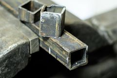 . metal clutches in them clamped square tube. there is still a piece on top. shallow depth of cut. Metal clutches in them clamped square tube. there is still a royalty free stock photo