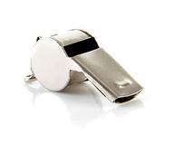 Metal coaches or referees whistle. Over white background Royalty Free Stock Photos