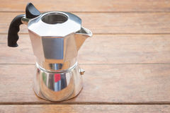 Metal coffee maker on wooden table Stock Photography