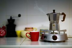Metal coffee percolator with coffee cup. Prepare hot coffee Royalty Free Stock Photo