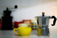 Metal coffee percolator with coffee cup. Prepare hot coffee Royalty Free Stock Photos