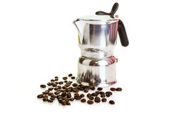 Metal coffeepot with beans on a white background Stock Images