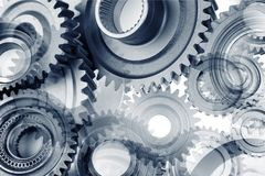 Cogs. Metal cog wheels bonding together Royalty Free Stock Photo