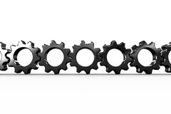 Metal cogs and wheels connecting Stock Photography
