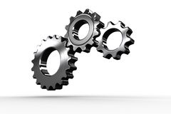 Metal cogs and wheels connecting Royalty Free Stock Images