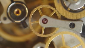 Metal cogwheels inside clockwo stock footage